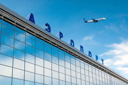depart: The modern russian airport with airplane over it