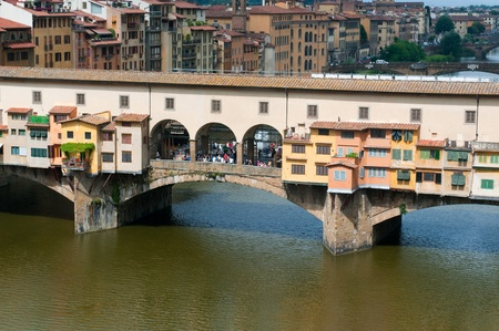 sightseeng: FLORENCE, ITALY - JUNE 2010. Crowds of tourists visit the Ponte Vecchio (