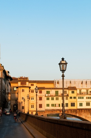 sightseeng: FLORENCE, ITALY - JUNE 2010. Bank near the Ponte Vecchio (Old Bridge) at evening. Florence, Tuscany, Italy. Editorial