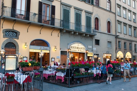 FLORENCE, ITALY - JUNE 2010. Street restaurants on Piazza della Signoria at evening. Florence, Tuscany, Italy.