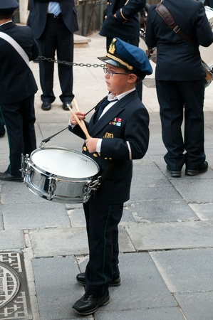 Syracuse, Italy - April 30, 2011: Young street musician play a music. Street holiday in Suracuse at April 30, 2011.