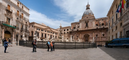palermo: Palermo, Italy - May 2, 2011: Crowds of tourists visit piazza Pretoria, one of the main sight in Palermo. Sicily, Italy