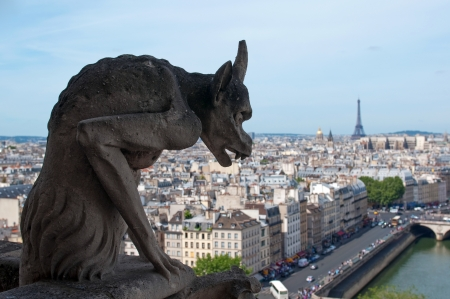 Famous Chimera (demon shape) overlooking the Eiffel Tower from Notre Dame of Paris