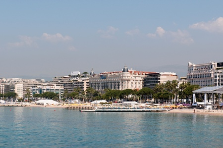 CANNES, FRANCE - MAY 23, 2011: Coastline and Croisette bulevard with luxury hotel in Cannes on May 23, 2011 in Cannes, France.