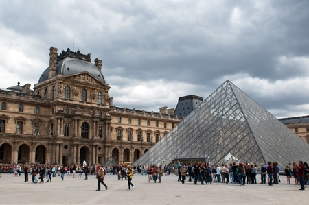 PARIS, FRANCE - MAY 26, 2011: Queue of visitors to the pyramid - main entrance to the Louvre on May 26, 2011, France Editorial