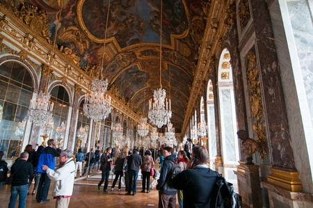 PARIS, FRANCE - MAY 27, 2011: Crowds of tourists visit the Palace of Versailles and hall of mirrors on May 27, 2011, France. Editorial