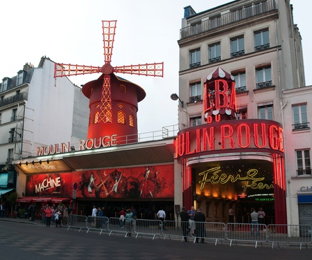 PARIS, FRANCE - MAY 28, 2011: The Moulin Rouge at the evening on May 28, 2011, France. Moulin Rouge is a famous cabaret built in 1889 and is located in the Paris red-light district of Pigalle.