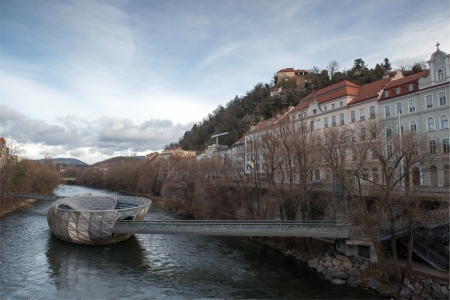attraktion: Murinsel - artificial floating platform in the middle of the Mur river, designed by New York artist Vito Acconci for the Graz, Austria on January 5, 2013
