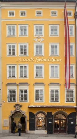 Old house on Getreidegasse where the W.A. Mozart was born on January 13, 2013 in Salzburg, Austria. Mozart is known as the one of the most famouse composers of the classical music. Stock Photo - 18605041