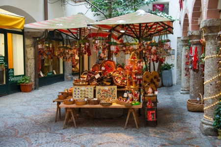 Souvenirs kiosk with toys, magnets and national austrian furnish on Getreidegasse street on January 13, 2013 in Salzburg, Austria.  Stock Photo - 18605072