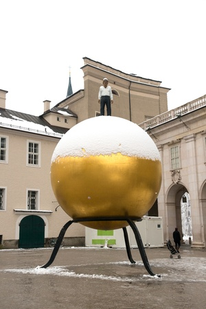 Sphera located at Salzburg, Austria on January 13, 2013. Every Year, the Salzburg Foundation chooses a piece of public artwork for the city. The artist of the this piece of artwork was Stephan Balkenhol Stock Photo - 18605051