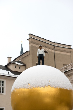 Sphera located at Salzburg, Austria on January 13, 2013. Every Year, the Salzburg Foundation chooses a piece of public artwork for the city. The artist of the this piece of artwork was Stephan Balkenhol Stock Photo - 18605042