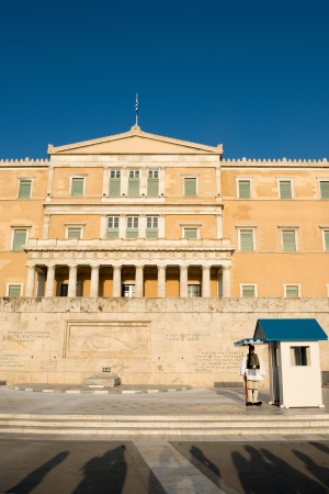 evzone: ATHENS, GREECE - May 5; Greece Parliament building with Evzone (presidential guards) dressed in traditional Greek uniform on May 5, 2013 in Athens. Greece