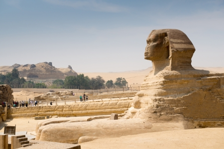 CAIRO - May 8:  Famous ancient statue of Sphinx in Giza  on May 8, 2013, Egypt. Every day crowds of tourists visit the Sphinx in Giza