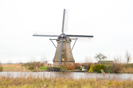 watermanagement: Traditional Dutch windmill in winter Kinderdijk. Netherlands. Stock Photo