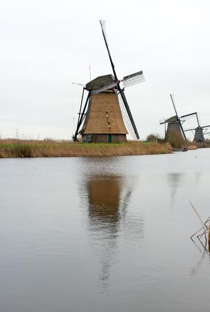 Traditional Dutch windmill in winter Kinderdijk. Netherlands. photo