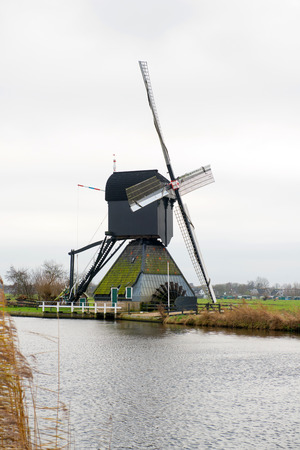 Traditional Dutch windmill in winter Kinderdijk. Netherlands. photo