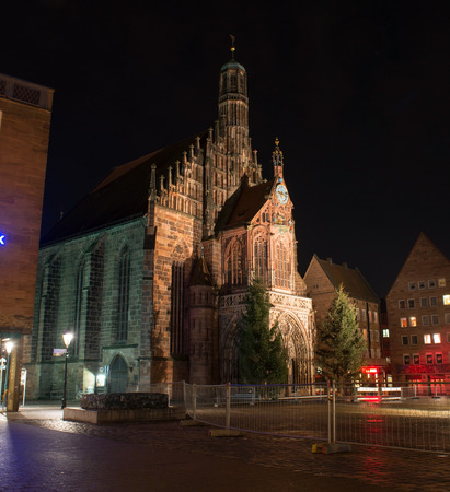 hauptmarkt: NUREMBERG, GERMANY - JAN, 4: View of the Frauenkirche (Our Ladys Church) am Hauptmarkt at night in Nuremberg, Germany on January 4, 2014 Editorial