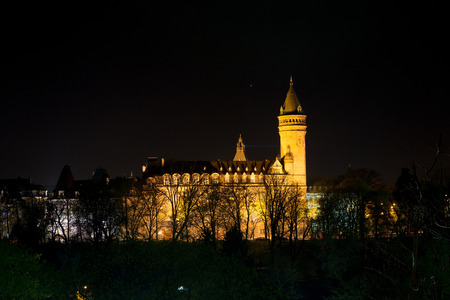 state owned: Tower of the state owned savings bank is the most famous bank building of Luxembourg at night Editorial