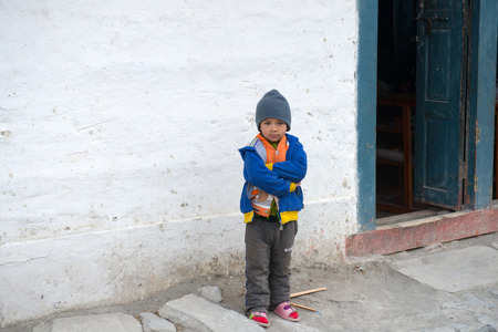 indigence: JOMSOM, NEPAL - MAY 06, 2014; Portrait of unidentified little boy in a small mountain village on Annapurna circuit on 06 May 2014 Editorial
