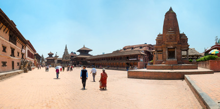 closed community: BHAKTAPUR, NEPAL-MAY 09, 2014: Every day crowds of tourists visited a Durbar square of Bhaktapur, on May 09, 2014. Bhaktapur  is a cultural gem in Nepal. Editorial