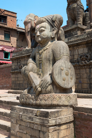 closed community: The guard of Nyatapola temple on Taumadhi Tole near Durbar square of Bhaktapur on May 09, 2014. Bhaktapur  is a cultural gem in Nepal.