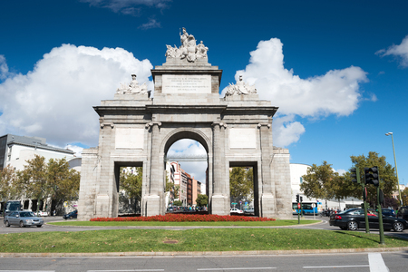 toledo town: MADRID, SPAIN - OCT 12, 2014: The Gate of Toledo inside Glorieta Puerta de Toledo in the center of Madrid, Spain on Oct 12, 2014. Editorial