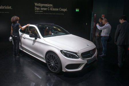 coupe: FRANKFURT, GERMANY - SEPTEMBER 16, 2015: Frankfurt international motor show (IAA) 2015. Mercedes-Benz C-classe Coupe - world premiere