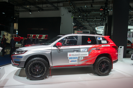 "outlander: FRANKFURT, GERMANY - SEPTEMBER 16, 2015: Frankfurt international motor show (IAA) 2015. Rally ""Baja Portalegre 500"" version of the Mitsubishi Outlander PHEV - European premiere"