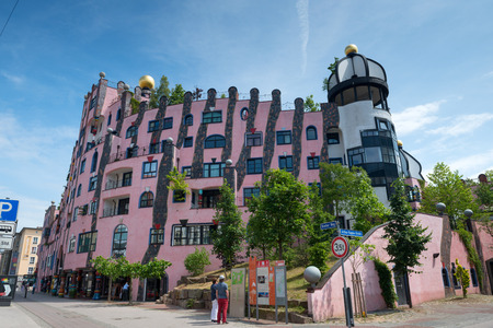 windowpanes: MAGDEBURG, GERMANY - JUNE 07, 2015: Hundertwasser House (Green Citadel) - one of the most famous landmarks in Magdeburg, Germany