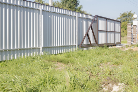 Fence and sliding gates made of metal
