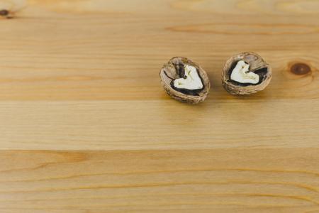 Chopped walnut in the shape of a heart 写真素材