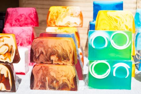 Handmade multi-colored flavored soap on the counter