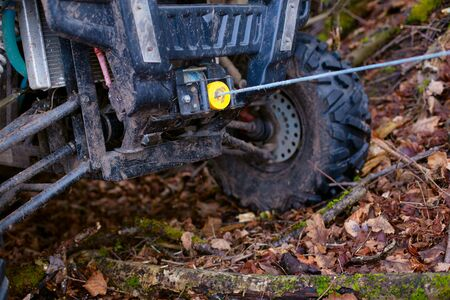 The winch is coupled with a buggy that slid into a ditch during extreme riding