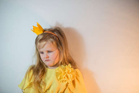 Little girl in a crown with a sad expression on her face 写真素材 - 156943512