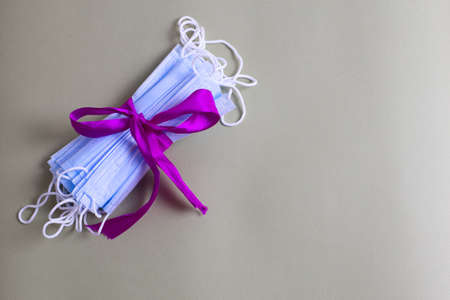 A gift in the form of medical masks. Actual gift concept