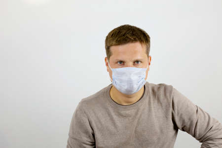 Open gaze of a man wearing a protective medical mask. The concept of health and victory over viruses