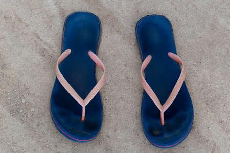 Blue flip-flops left on the concrete floor. Top view of the flip-flops