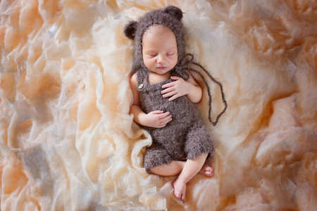 Cute newborn sleeping baby. Professional photo of a sleeping newborn baby