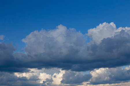 Close-up of huge white clouds and blue sky before rain. Rainy clouds