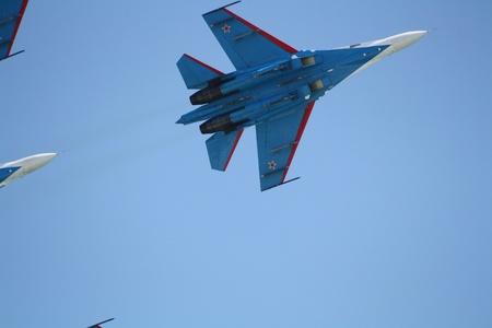 gimmick: Russia, Gelendzhik, Gidroaviasalon - 2012, Aircraft Su-27 of Aerobatic team Rusian knights in flight