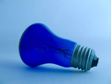 the electrical lamp on the blue background  photo