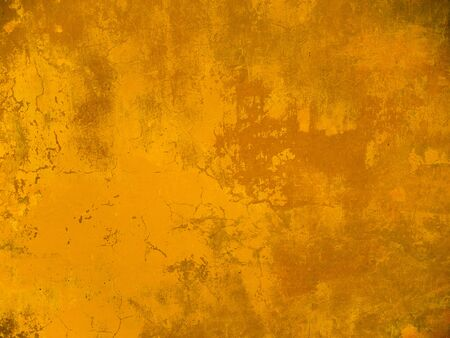 The texture of the wall with the chipped old antique plaster. Abstract background painted in Golden yellow Banque d'images