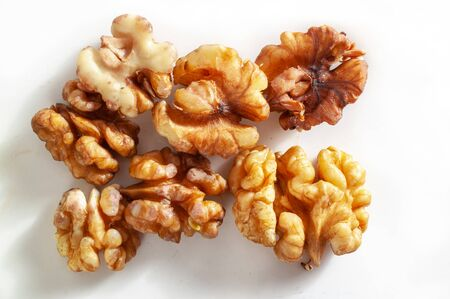 Peeled walnuts on a plate, an element of a balanced healthy diet