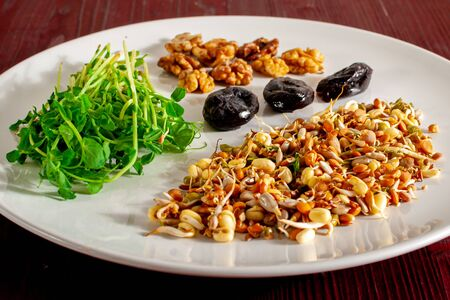 A collection of vegan healthy foods high in protein, vitamins, minerals, antioxidants, fiber, fat and carbohydrates. The concept of a balanced healthy ethical diet.