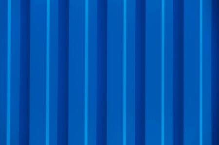 Blue corrugated metal panel texture. Roofing material and building finishing. Copy space. Zdjęcie Seryjne
