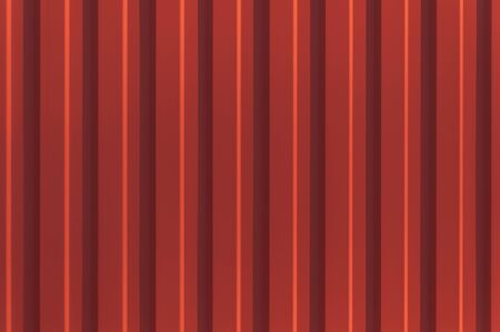 Red corrugated metal panel texture. Roofing material and building finishing. Copy space. Zdjęcie Seryjne