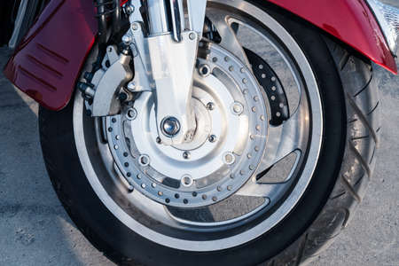 Front wheel of a motorcycle with a braking system, close-up.