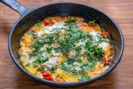 Poached eggs with tomatoes and spices called