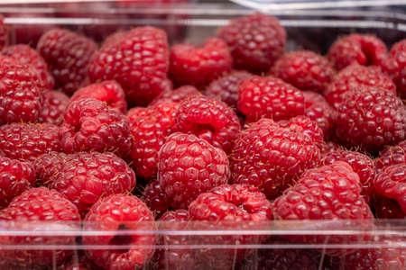 Fresh raspberries, raspberry tray close-up at farmer's market Stok Fotoğraf